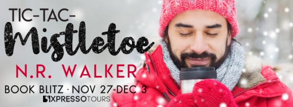 Banner image for the novel Tic Tac Mistletoe by N.R. Walker. Writing to the left of the image and on the right is a man in a red beanie and sweater smiling, with his eyes closed.
